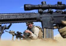 """<p>Американские солдаты ведут бой у города Марджах 13 февраля 2010 года. Один из лидеров экстремистского движения """"Талибан"""" Мулла Абдула Гани Барадар захвачен в результате совместного рейда пакистанских и американских разведок, сообщил представитель США, однако талибы отрицают эти данные. REUTERS/Goran Tomasevic</p>"""