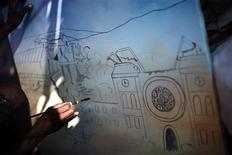<p>Artist Louis Saurel paints about the earthquake at his makeshift tent in Petionville, Port-au-Prince February 16, 2010. REUTERS/Carlos Barria</p>