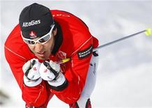 <p>Blind cross country skier Brian McKeever trains at the Canmore Nordic Centre in Alberta, February 3, 2010. Legally blind since his late teenage years, Canada's McKeever will achieve a long-cherished dream and a unique place in the record books when he represents his country at this month's Vancouver Games. The popular cross country skier from Canmore, Alberta will become the first athlete to compete in both a Winter Olympics and a Paralympics and he fervently hopes to inspire as many people as he can -- whether they are disabled or able-bodied. REUTERS/Todd Korol</p>