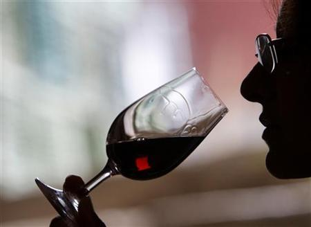 A wine selector tastes red wine in the village of Brestovitsa, about 150km (93miles) east of the capital Sofia, December 8, 2009. REUTERS/Oleg Popov