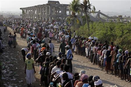 Haitians line up during a food distribution at the Cite Soleil neighborhood in Port-au-Prince February 15, 2010. REUTERS/Ivan Alvarado
