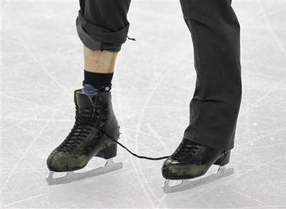 The ripped laces of Japan's Nobunari Oda are seen during the men's free skating figure skating competition at the Vancouver 2010 Winter Olympics, February 18, 2010. REUTERS/Gary Hershorn