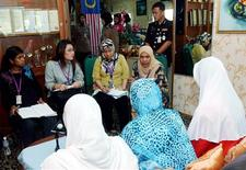 "<p>Journalists (facing camera) interview three women who were caned for having sex out of wedlock, at a prison in Kajang outside Kuala Lumpur February 18, 2010. Three Malaysians who became the first women to be caned under the country's Islamic laws said they ""deserved"" their punishment and that it would help stem sex outside marriage. Photo taken February 18, 2010. REUTERS/The New Straits Times Press/Mokhsin Abidin</p>"