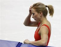 <p>Canadian figure skater Joannie Rochette is seen during training during the Vancouver 2010 Winter Olympics February 21, 2010. REUTERS/Todd Korol</p>