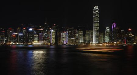 Boats sail in Hong Kong's Victoria Harbour with a clear evening view of the city's financial central district July 25, 2008. REUTERS/Bobby Yip (CHINA) (BEIJING OLYMPICS 2008 PREVIEW)