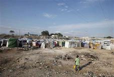 <p>A boy walks at a makeshift camp in Port-au-Prince February 20, 2010. REUTERS/St-Felix Evens</p>
