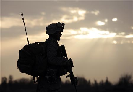 A U.S. Marine from Bravo Company of the 1st Battalion, 6th Marines walks during an operation in Marjah, Helmand province, February 21, 2010. REUTERS/Goran Tomasevic