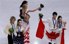 <p>From L-R, silver medallists Charlie White and Meryl Davis of the United States, bronze medallists Russia's Maxim Shabalin and Oksana Domnina, and gold medallists Canada's Scott Moir and Tessa Virtue stand together after the ice dance figure skating event at the Vancouver Winter Olympics, February 22, 2010. REUTERS/David Gray</p>