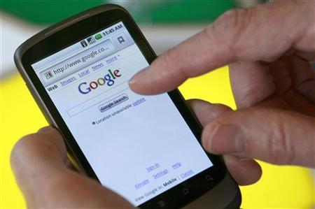 A model demonstrates a Nexus One smartphone, the first mobile phone Google will sell directly to consumers based on its Android platform, after a news conference at Google headquarters in Mountain View, California January 5, 2010. REUTERS/Robert Galbraith