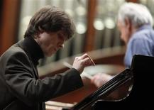 <p>Rafal Blechacz smiles as he plays during a rehearsal of the 200th Anniversary of Fryderyk (Frederic) Chopin's Birthday Special Concert at the Warsaw Philharmonic concert hall February 22, 2010. REUTERS/Kacper Pempel</p>