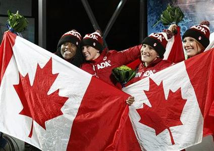 Canada's silver medalists Shelley-Ann Brown (L) and Helen Upperton (2nd,L) celebate with compatriot gold medalists Kaillie Humphries and Heather Moyse (R) after the women's bobsleigh at the Vancouver 2010 Winter Olympics in Whistler, British Columbia, February 24, 2010. REUTERS/Jim Young