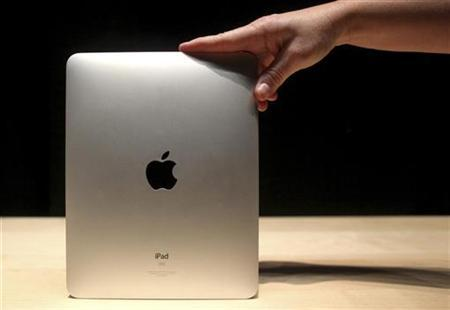 A host shows off the back of Apple's new ''iPad'' in San Francisco, January 27, 2010. REUTERS/Kimberly White