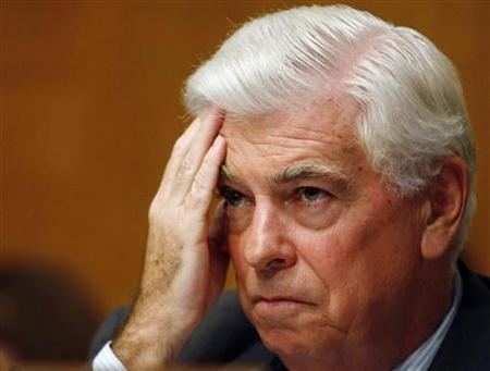 Senate Banking Committee Chairman Christopher Dodd listens to a testimony at the Senate Banking Committee on Capitol Hill in Washington in this July 23, 2009 file photo. REUTERS/Larry Downing/Files
