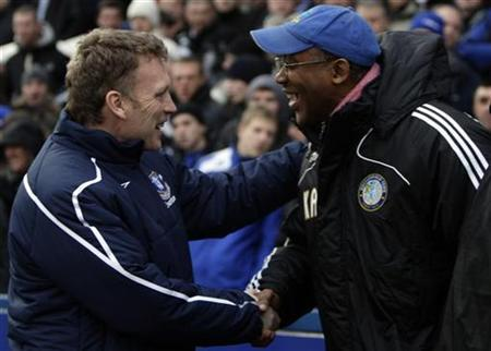 Everton's manager David Moyes (L) shakes hands with Macclesfield Town's manager Keith Alexander during their English FA Cup third round soccer match at the Moss Rose in Macclesfield, central England, January 3, 2009. REUTERS/Darren Staples
