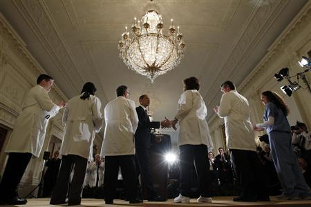 U.S. President Barack Obama shakes hands with healthcare workers after speaking about healthcare reform from the East Room of the White House in Washington March 3, 2010. REUTERS/Kevin Lamarque