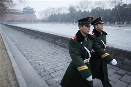 Paramilitary policemen patrol around the Forbidden City, in Beijing March 4, 2010. REUTERS/Nir Elias