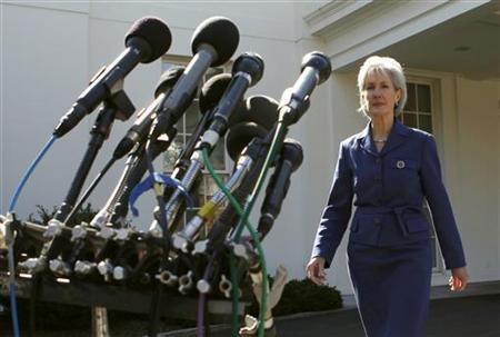 Secretary of Health and Human Services Kathleen Sebelius walks to a microphone stand to speak to reporters following her meeting with health insurance company executives and related industry officials at the White House in Washington, March 4, 2010. REUTERS/Kevin Lamarque
