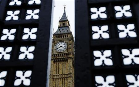 The Big Ben clock tower of the Houses of Parliament is seen through a gap in a gate in London February 14, 2010. REUTERS/Luke MacGregor