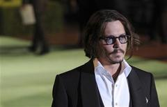 "<p>Actor Johnny Depp poses for photographers as he arrives for the Royal World Premiere of ""Alice In Wonderland"" at Leicester Square in London February 25, 2010. REUTERS/Jas Lehal</p>"