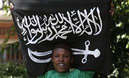 <p>A protestor holds the flag of Somali rebel group al Shabaab during a demonstration outside the Jamia Mosque in Kenya's capital Nairobi, January 15, 2010. REUTERS/Thomas Mukoya</p>