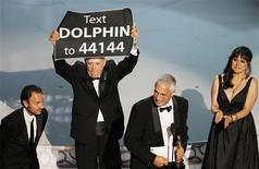 "<p>Director Louie Psihoyos (2nd R) accepts an award with producer Fisher Stevens (L), producer Paula DuPre Pesman (R), as cast member Richard O'Barry holds up a sign after ""The Cove"" won best documentary feature during the 82nd Academy Awards in Hollywood March 7, 2010. REUTERS/Gary Hershorn</p>"