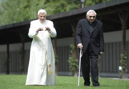 Pope Benedict XVI strolls in a garden with his brother Bishop Georg Ratzinger during his annual holiday in Bressanone, northern Italy in this July 31, 2008 file photo. REUTERS/Osservatore Romano/Files