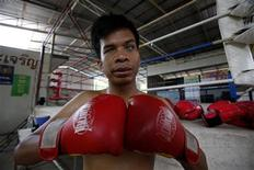 <p>Blind boxer Sujet Salee, 29, poses at his boxing camp in Surin province, 457 km (283 miles) northeast of Bangkok, February 12, 2010. Sujet, who was blind at birth, earns about 1,500 baht ($45) per match. The boxer does not think that blindness is a handicap and he has proved just that by winning several matches against blindfolded opponents. REUTERS/Sukree Sukplang</p>