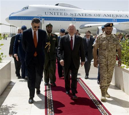U.S. Defence Secretary Robert Gates (C) walks with U.S. Ambassador to the UAE Richard Olson (L) and Emirati Deputy Chief of Staff Major General Ali al-Kaabi (R) upon his arrival at the Al-Dhafra Air Base in Abu Dhabi March 11, 2010. REUTERS/Jim Watson/Pool
