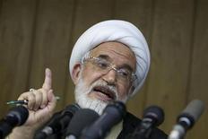 """<p>Мехди Каруби выступает на пресс-конферении в Тегеране 9 июня 2009 года. Лидер иранской оппозиции Мехди Каруби накануне празднования Навруза заявил, что Исламская республика """"погрязла в деспотизме"""". REUTERS/Raheb Homavandi</p>"""