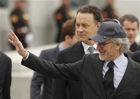 Executive Producers of the mini series ''The Pacific'', director Steven Spielberg (R) and actor Tom Hanks arrive at a tribute to veterans who served in the Pacific theater of World War II at the World War II Memorial on the Washington Mall, March 11, 2010. REUTERS/Jason Reed