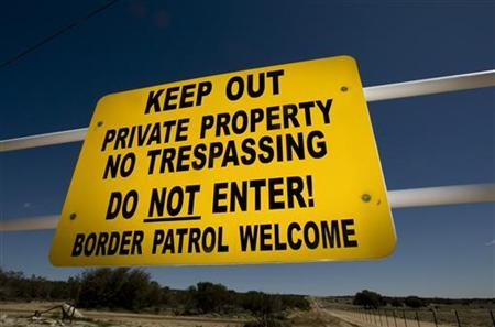 A sign on the fence of a ranch along the US/Mexico border that discourages all trespassers but the Border Patrol near Campo, California in this photo taken March 17, 2008. REUTERS/Fred Greaves