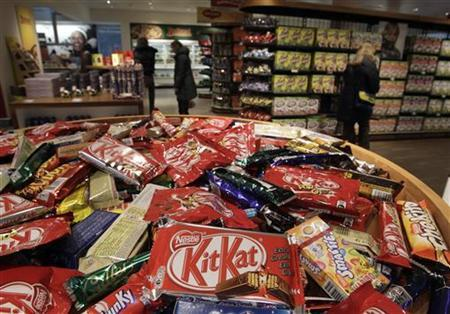 Different types of chocolate bars are seen in the company supermarket at the Nestle headquarters in Vevey February 19, 2010. REUTERS/Denis Balibouse