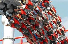 "<p>Visitors ride the ""Battlestar Galactica"" duelling roller coaster at the Universal Studios theme park in Singapore March 18, 2010. The park features a variety of attractions including roller coasters and pyrotechnic shows. It is part of the Resorts World Sentosa development, which includes a casino and four hotels in addition to the theme park on Singapore's Sentosa Island. REUTERS/Vivek Prakash</p>"