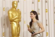 "<p>Actress Sandra Bullock smiles with her best actress Oscar after winning for her role in ""The Blind Side"" backstage at the 82nd Academy Awards in Hollywood March 7, 2010. REUTERS/Lucy Nicholson</p>"