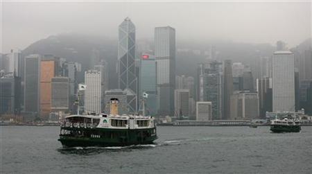 Star Ferries cross the Victoria Harbour from Hong Kong island to Kowloon in this file photo from December 15, 2009. REUTERS/Tim Chong