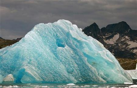 A deep blue iceberg floats in a fjord south of Tasiilaq in eastern Greenland August 2, 2009. The blue color is a result of compression and repeated thawing and refreezing. REUTERS/Bob Strong