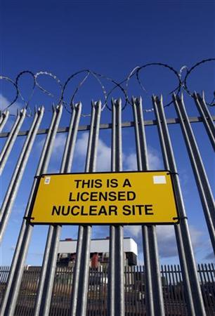 A sign is seen on the security fence of British Energy's Heysham nuclear power station, northern England April 14, 2008 file photo. REUTERS/Darren Staples