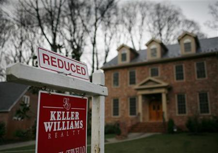 A house for sale is pictured in Alexandria, Virginia, March 22, 2010. REUTERS/Molly Riley