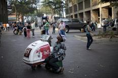 <p>Haitian ice-cream vendor Gleis, waits for clients as he sits beside his cart on the boulevard of Catia in Caracas March 5, 2010. REUTERS/Carlos Garcia Rawlins</p>