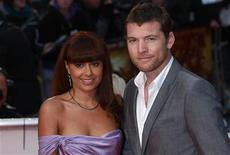 "<p>Sam Worthington and Natalie Mark pose for photographers at the world premiere of his film ""Clash of the Titans"" in Leicester Square, central London, March 29, 2010. REUTERS/Andrew Winning</p>"