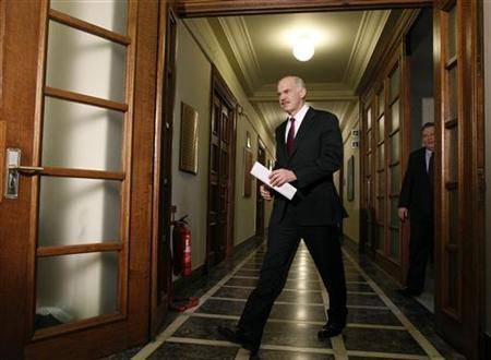 Greece's Prime Minister George Papandreou enters a hall where a cabinet meeting will take place inside the parliament in Athens March 18, 2010. REUTERS/Yiorgos Karahalis