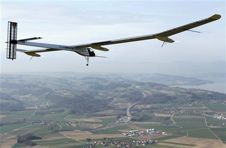German test pilot Markus Scherdel steers the solar-powered Solar Impulse HB-SIA prototype airplane during his first flight over Payerne April 7, 2010. REUTERS/Christian Hartmann