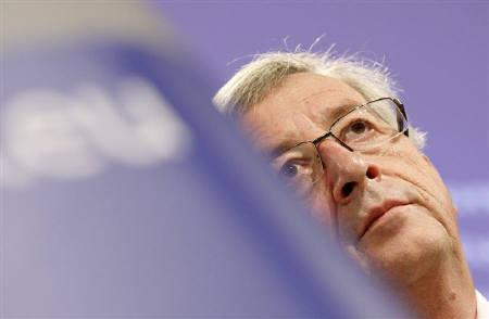Luxembourg's Prime Minister Jean-Claude Juncker, who is also Chairman of the Eurogroup, listens to a question during a news conference with European Commissioner for Finance Olli Rehn (not pictured) in Brussels April 11, 2010. REUTERS/Sebastien Pirlet