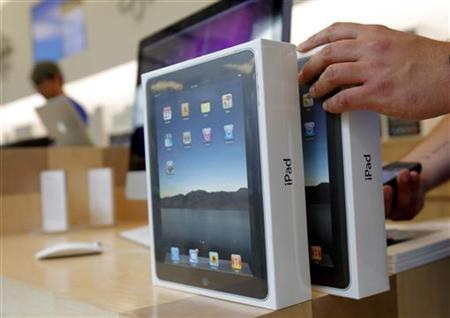 Apple iPads are prepared for purchase during an iPad launch event at an Apple store in San Francisco, April 3, 2010. REUTERS/Robert Galbraith