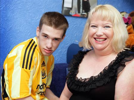 Sharon Bernardi, 44, with her son Edward, 20, who suffers from Leigh's disease, a form of mitochondrial disease. REUTERS/Newcastle University/Handout