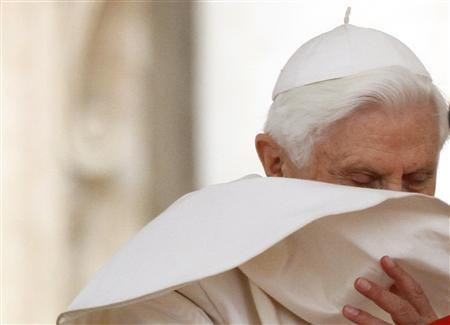 A gust of wind blows Pope Benedict XVI's mantle during the weekly Wednesday general audience in St. Peter square at the Vatican April 14, 2010. REUTERS/Stefano Rellandini