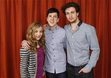"<p>Actors (L-R) Chloe Moretz, Christopher Mintz-Plasse, and Aaron Johnson pose for a portrait during a media day promoting the film ""Kick-Ass"" in New York April 8, 2010. REUTERS/Lucas Jackson</p>"
