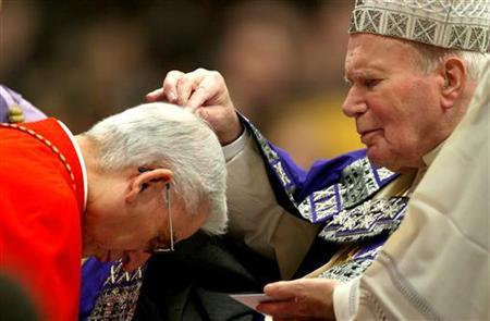 Pope John Paul II spreads ash on Colombian Cardinal Dario Castrillon Hoyos during a solemn celebration is Saint Peter's Basilica for Ash Wednesday at the Vatican February 25, 2004. REUTERS/Max Rossi