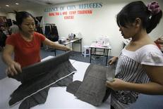 "<p>Myanmar refugees cut fabrics at the ""Mang Tha"" training centre in Kuala Lumpur April 14, 2010. REUTERS/Bazuki Muhammad</p>"