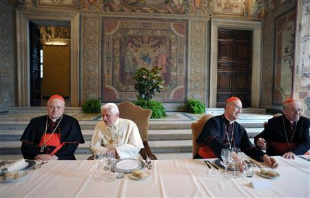 Pope Benedict XVI sits with Italian cardinals Angelo Sodano (L), Tarcisio Bertone (2nd R) and Giovanni Battista Re during a lunch offered to the cardinals to mark his fifth anniversary of pontificate at the Vatican April 19, 2010. REUTERS/Osservatore Romano
